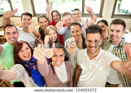Group of happiness students with raised hands - stock photo