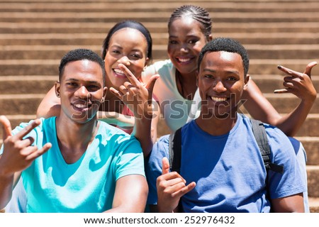 group of happy african american college students hand signs - stock photo