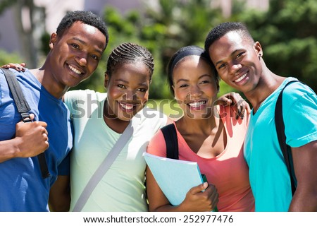 group of happy african university students looking at the camera - stock photo