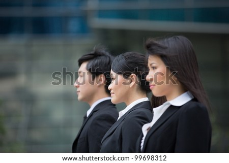 Group of happy Asian business people standing in row.