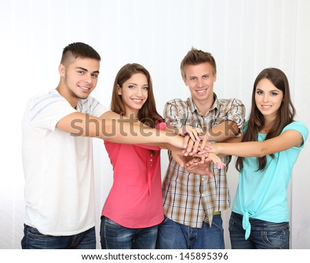 Group of happy beautiful young people at room