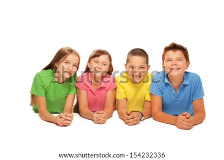 Group of happy boys and girls laying in a row isolated on white
