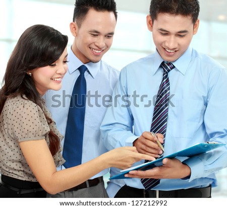 group of happy business people doing presentation