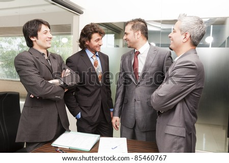Group of happy businessmen having a casual discussion after the official meeting. - stock photo
