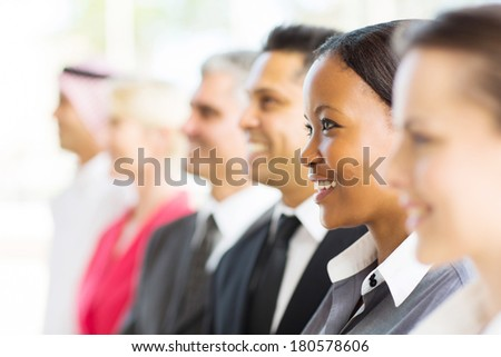 group of happy businesspeople looking away - stock photo