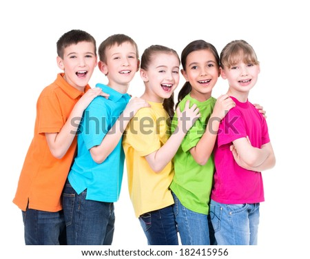 Group of happy children in colorful t-shirts stand behind each other putting hands on the shoulders on white background.
