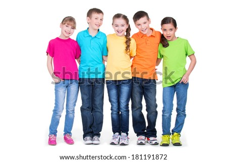 Group of happy children in colorful t-shirts standing together in full length on white background. - stock photo