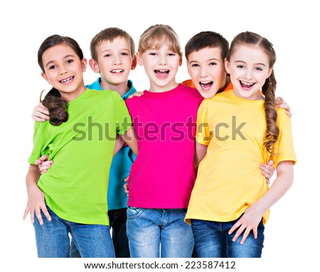 Group of happy children in colorful t-shirts standing together on white background. - stock photo