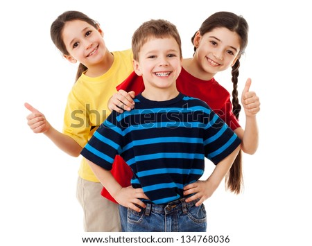 Group of happy children with thumbs up sign, isolated on white - stock photo