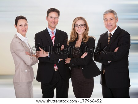 Group Of Happy Confident Businesspeople Standing Together - stock photo