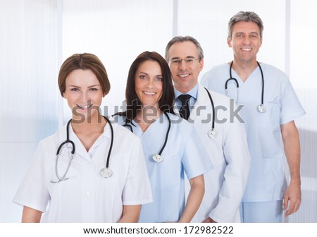 Group Of Happy Doctor Standing In A Row Together