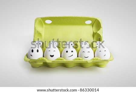 Group of happy eggs with smiling faces representing a social network. Ten white eggs in a carton box. On a gray background