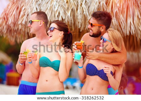 group of happy friends having fun on tropical beach, summer holiday party - stock photo