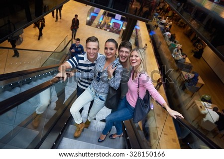 group of happy  friends in shopping mall have fun - stock photo