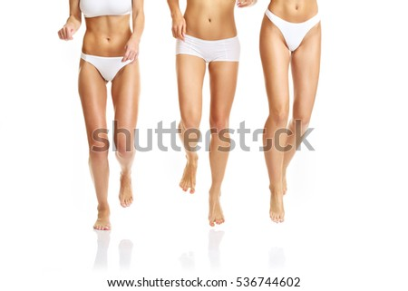Group of happy friends in underwear over white background