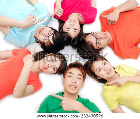 group of happy friends smiling with heads together - stock photo