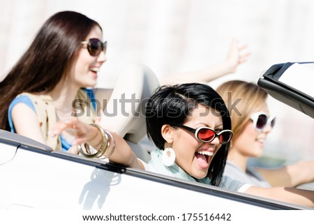 Group of happy girls in the auto. Little trip of teenage ladies - stock photo