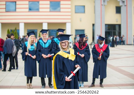 group of happy graduates celebrated - stock photo