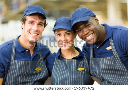 group of happy hardware shop workers - stock photo