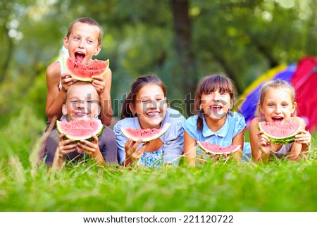 group of happy kids eating watermelons - stock photo