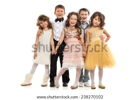 Group of happy kids in celebratory clothes. Isolated on white background. Holidays, christmas, new year, x-mas concept. - stock photo