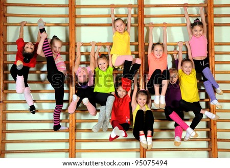 Group of happy kids in the gym - stock photo