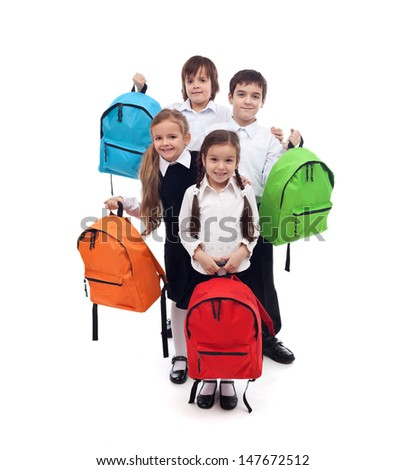Group of happy kids with colorful school bags - back to school concept - stock photo