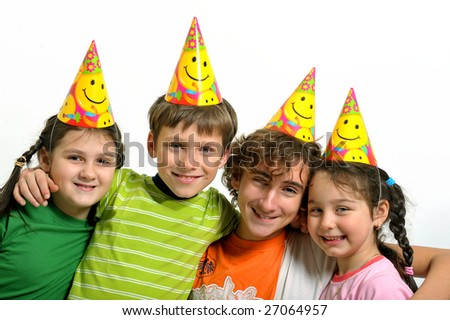 Group of happy kids with party horn - stock photo