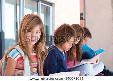 Group of happy little school kids in school - stock photo