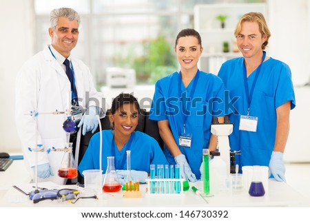group of happy medical lab technicians in laboratory - stock photo