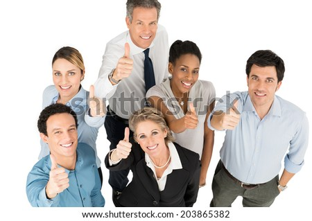 Group Of Happy Multi Ethnic Businesspeople Showing Thumb Up - stock photo