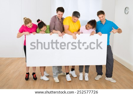 Group Of Happy Multiethnic People Holding Blank Placard - stock photo