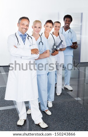 Group Of Happy Multiracial Doctors Standing In A Row