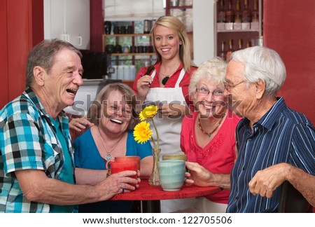 Group of happy people at cafe with waitress - stock photo