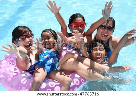 group of happy people enjoying at the pool - stock photo