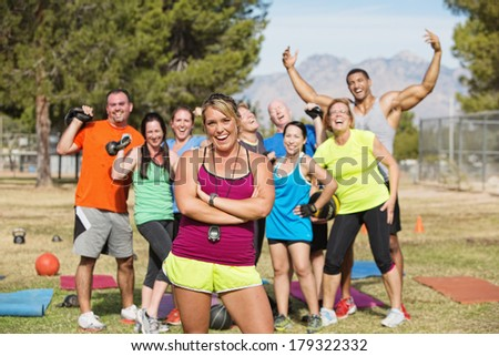 Group of happy people in boot camp fitness class - stock photo
