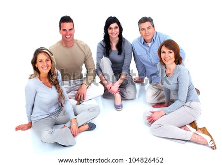 Group of happy people sitting on the floor. Isolated over white background. - stock photo