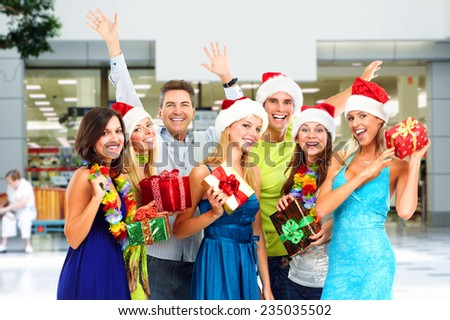 Group of happy people with Christmas gifts.  - stock photo