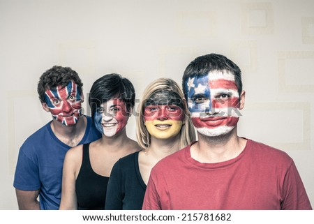 Group of happy people with painted flags on their faces.