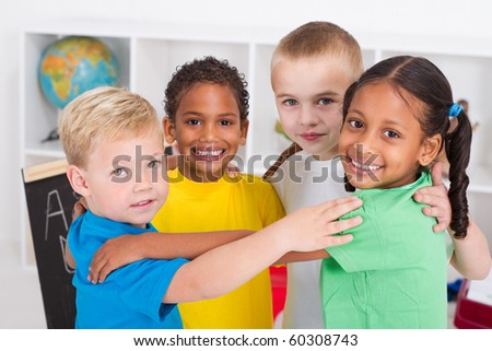group of happy preschool kids hugging