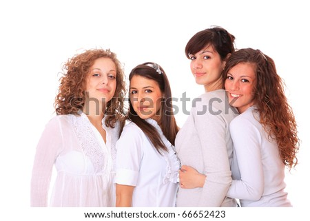 Group of happy pretty laughing girls over white background - stock photo