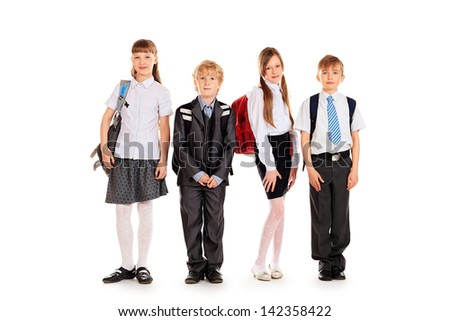 Group of happy schoolchildren standing together. Education. Isolated over white background.