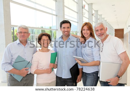 Group of happy senior people in training course - stock photo