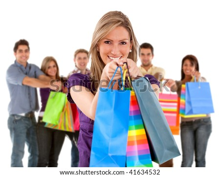 Group of happy shoppers with shopping bags isolated - stock photo