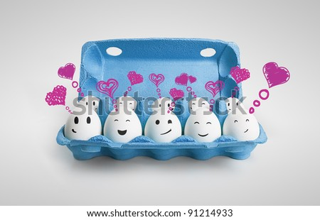 Group of happy smiling eggs with love heart speech bubbles and social chat sign. Ten white eggs in a carton box representing a social network. - stock photo