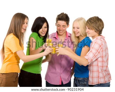 Group of happy smiling teenagers. Isolated white background, young students celebrating toasting with glasses of orange juice, drinking cocktails. - stock photo