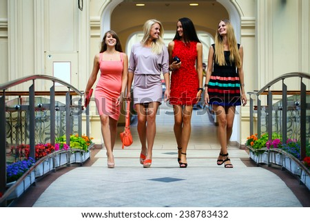 Group of happy smiling women shopping - stock photo
