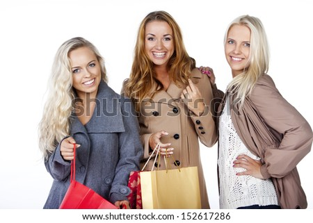 Group of happy smiling women shopping with colored bags  - stock photo