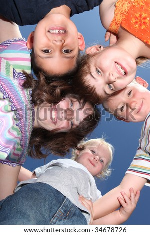 Group of Happy Smiling Young Kids Outside Having Fun - stock photo