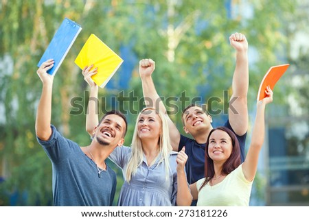 Group of happy students celebrating their success - stock photo